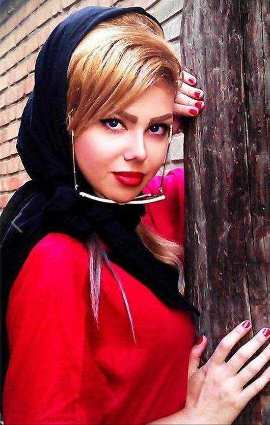 Girl of Enghelab Street Iranian woman who stood in Tehran street.