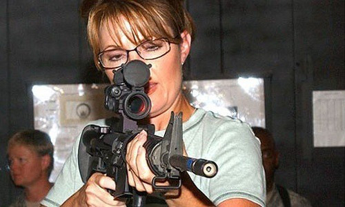 http://iranpoliticsclub.net/photos/sarah-palin3/images/Sarah%20Palin%20shooting%20gun.jpg